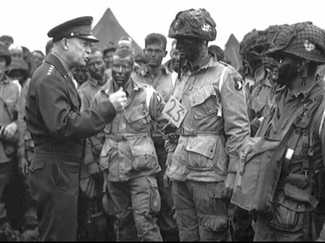 A photograph of General Dwight D. Eisenhower talking to paratroopers hours before the D-Day invasion features two men from North Carolina.