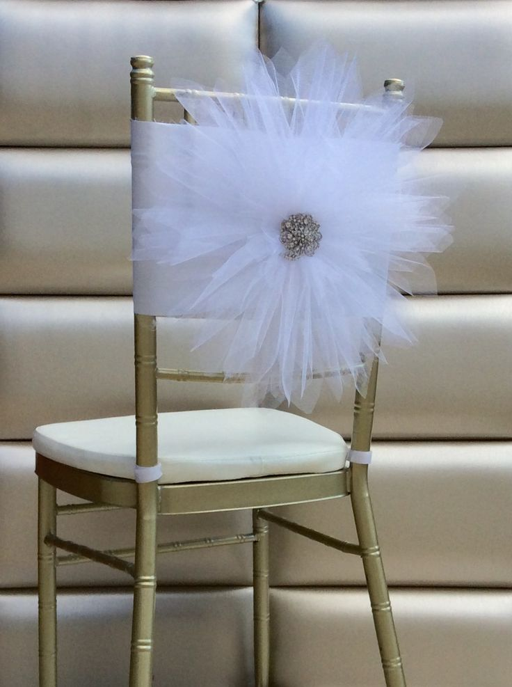 White tulle flower chair sash by FloraRosa Design...Don't forget personalized napkins for all of your wedding events! #itsallinthedetails www.napkinspersonalized.com