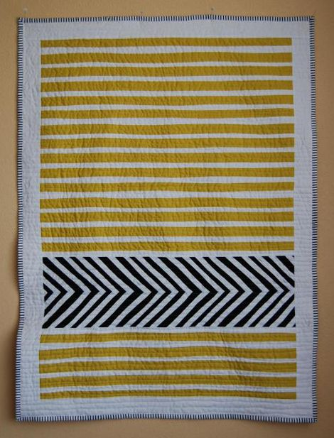 a quilt with a strip of chevron This would be great for a baby's room.