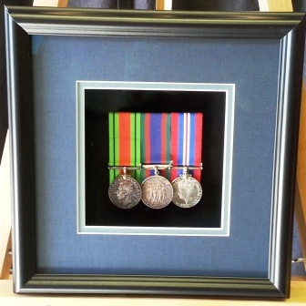 Magnetic front, open to take medals out. Matts can be in regimental colours, opening cut to requirement.
