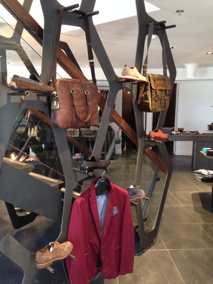 These laser cut panels were built for Burrows Clothiers in Oakville. They are used to display shoes, clothing and bags and span from the floor of the first level up to the second level.