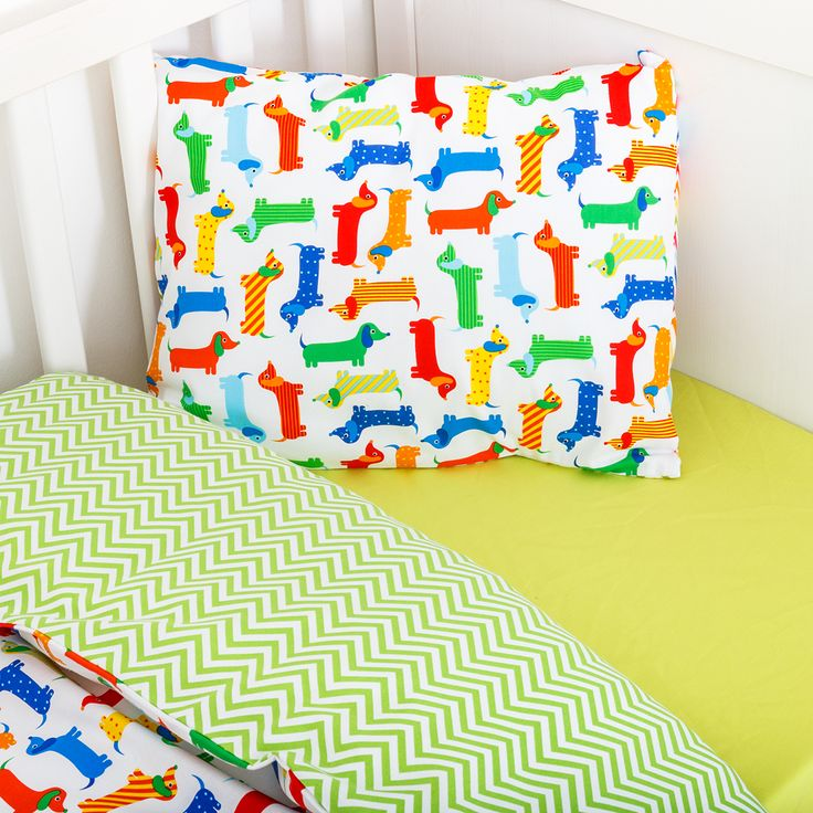 Sausage dogs in action. Colourful, happy and friendly sausage dogs will comfort your little one to sleep Soft 100% cotton duvet cover with co-ordinated green zig zag materials Matching green zig zag pillow case and Sausage dogs resting on the front side.