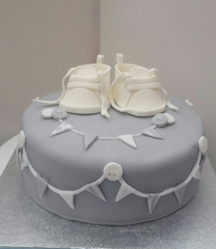 baby shower cake with sugar booties. I made blue and pink marble cake inside as my friend didnt find out the babies sex.