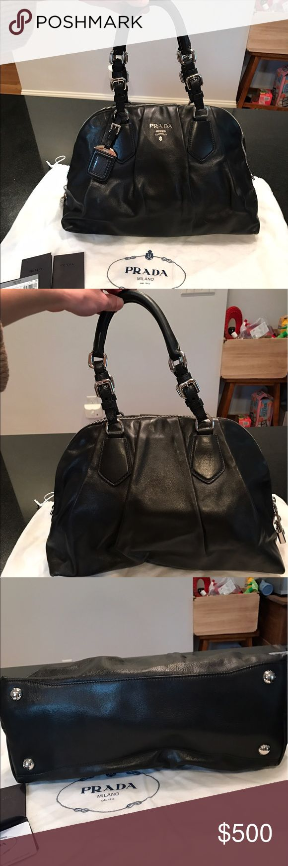 "Classic Black Prada Handbag Classic Black Smooth Leather Prada Handbag with Silver Hardware. Condition: Like New, Handles and hardware in great condition. Size: 15""L x 6"" W x 10"" H. Accessories: Silver lock and instructions of Use included. Card of Authentication. Prada name tag holder that came with bag. Prada brand cloth bag protectant. Damage: Very small light scratch on front of bag near bottom right (picture shows). Serial number inside interior pocket #100 Prada Bags Mini Bags"