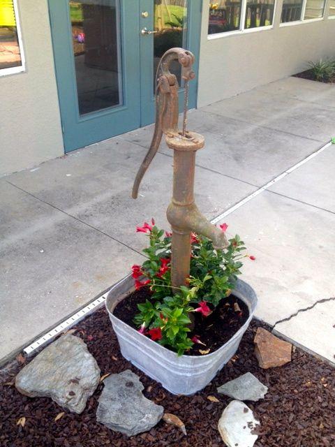 Landscape Ideas  We Repurpose pitcher pump and galvanized wash tub into a flower pot.