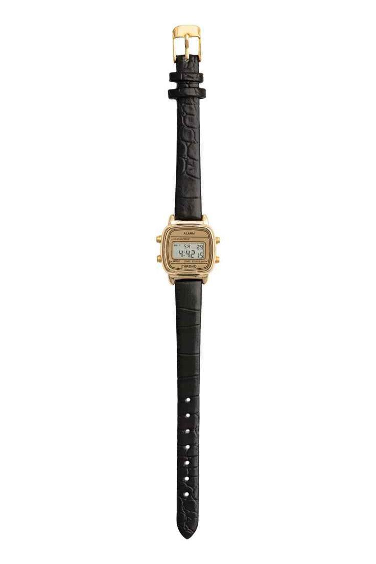 Reloj de pulsera digital: Reloj digital de metal con correa en piel sintética. Muestra la fecha y tiene alarma y cronómetro. Ancho aprox. de la correa 1 cm.