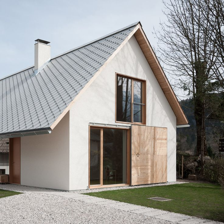 Slovenian studio Skupaj Arhitekti has reinterpreted Alpine architecture in this gabled house, which features a traditional pitched roof with cement shingles