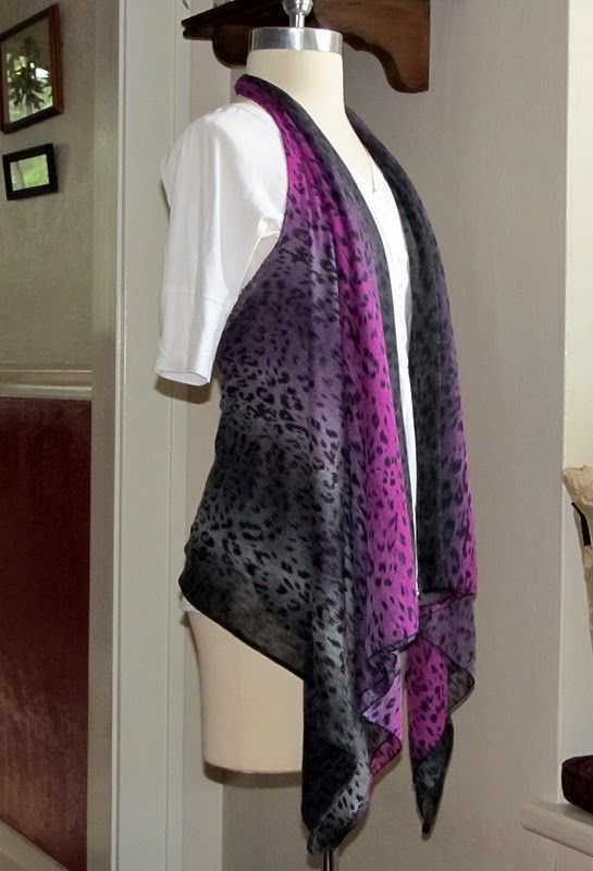 Make a vest out of a scarf! cute!!