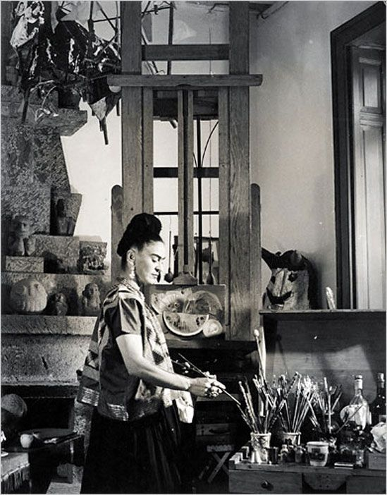 Frida Kahlo in her studio at Casa Azul, photographer Vicente Wolf