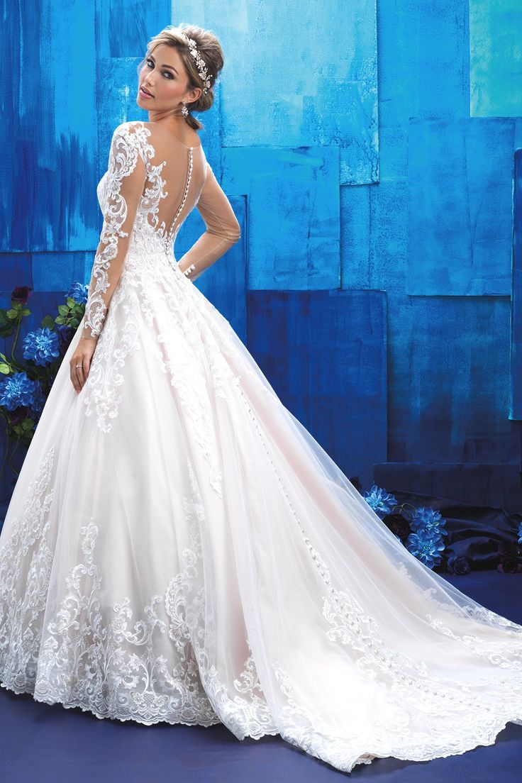 Romantic and regal, this full-skirted ballgown with lace sleeves is an elegant homage to the wedding gowns we dreamed about as little girls.