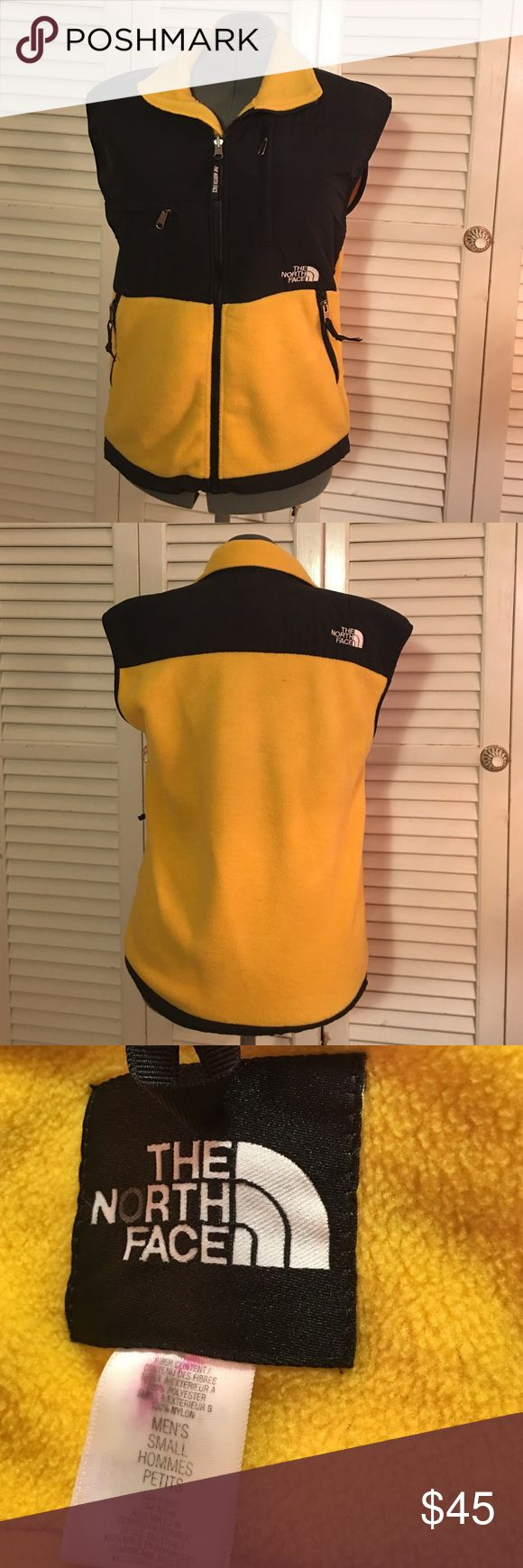"North Face Denali Fleece Vest The North Face Men's Denali Fleece vest. Yellow + black. Men's size small (could fit a woman). Zip up Fleece vest with multiple pockets. In gently worn, preloved condition (has marks on the tag, filled in O, not visible when worn). I DO NOT MODEL LISTINGS. Measurements approx. 26"" length, 20.5"" across. Love the item but not the price? Please make offers using the offer button. 🚫POSH ONLY, NO TRADES OR COMMENT OFFERS🚫 North Face Jackets & Coats Vests"