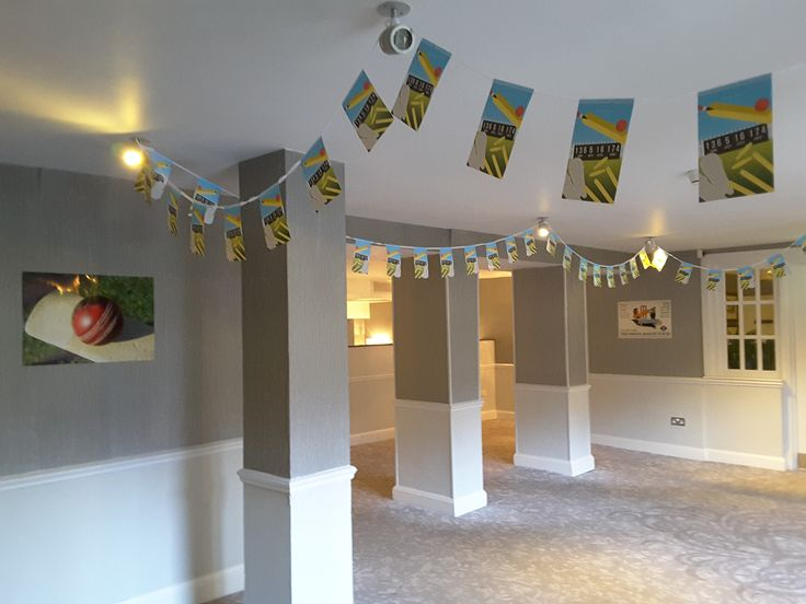 Cricket Bunting & Posters that joined the table centres for the Cricket themed party