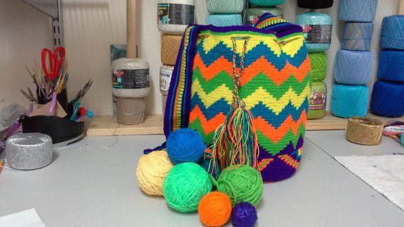 Check out this item in my Etsy shop https://www.etsy.com/listing/248775429/colombian-wayuu-mochila-crossbody