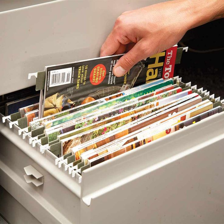 Magazine Storage - Can you actually find what you're looking for in your stack of saved magazines? Here's a great way to archive magazines, a method that one of our editors has been using at work for years. All you need is a bunch of hanging folders and a drawer that's set up for hanging them. Cut off the bottom of each folder about an inch below the rod. Drape your magazine over the rod and hang it in the drawer. The spines are easy to read, so you can find what you need quickly.