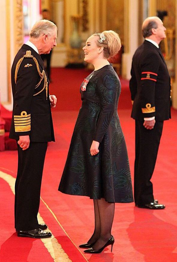 Prince Charles was seen chatting to singer Adele for several minutes after pinning on the MBE award at Buckingham Palace on 19.12.13