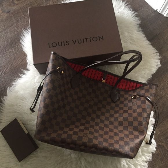 Louis Vuitton Neverfull MM Damier Redesigned interior with Louis Vuitton archive details. Textile-lined inside pocket. Natural cowhide leather trim. Golden color metallic pieces. Louis Vuitton Bags Travel Bags