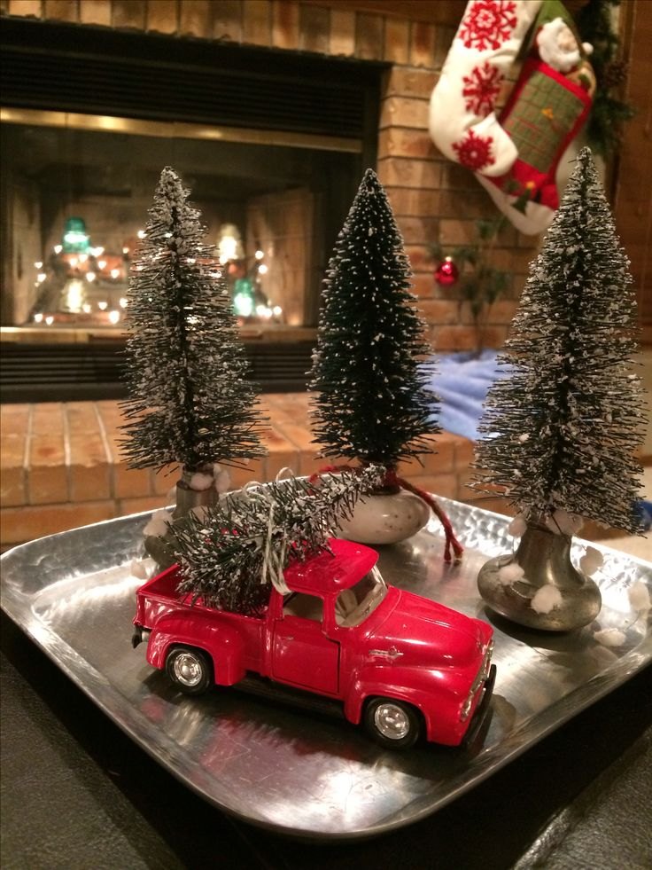 Took old door knobs to use as the tree stands and my old red truck has found the perfect tree. I'm a tad obsessed with repurposed Christmas ideas.