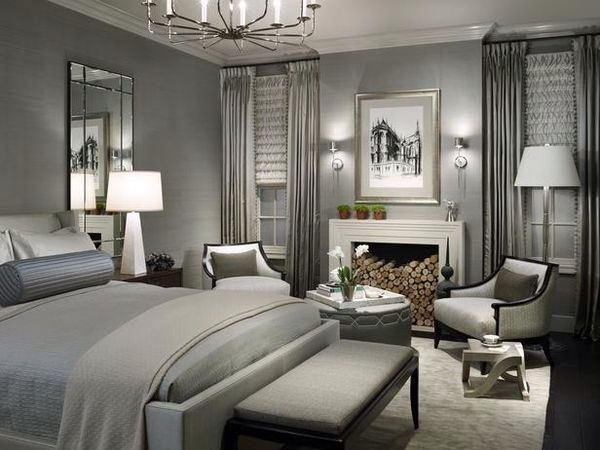 A cosy nook by the fire and a glamorous styled bedroom may just be the escape you need from a busy life. The fireplace can be filled with wood or plants when not being used. The wood could be transferred to an attractive chest. Photo credit- hgtv.com