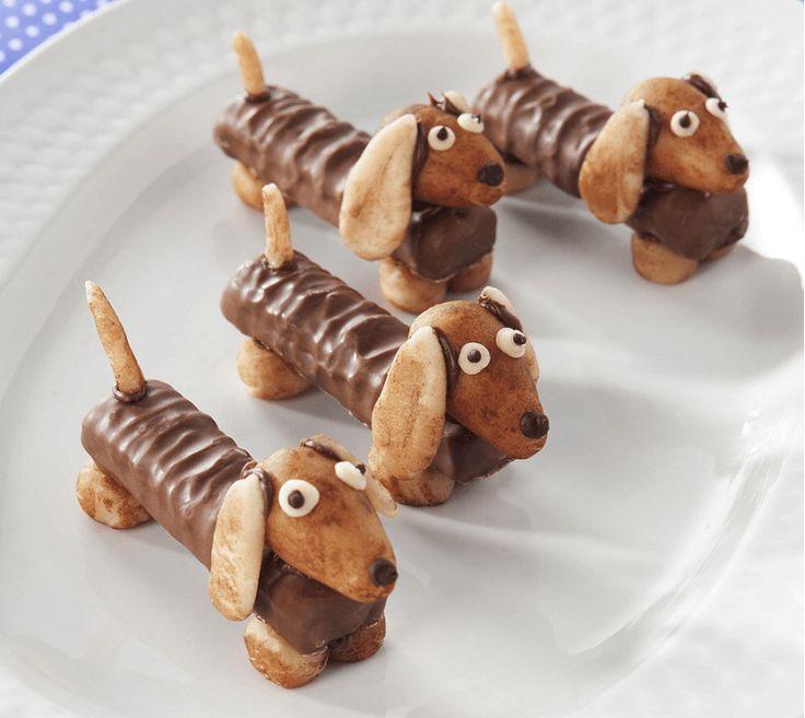 Hoe leuk zijn deze teckel hondjes als traktatie! En niet zo heel moeilijk om te maken. Kijk op onze website voor nog meer leuke traktaties.