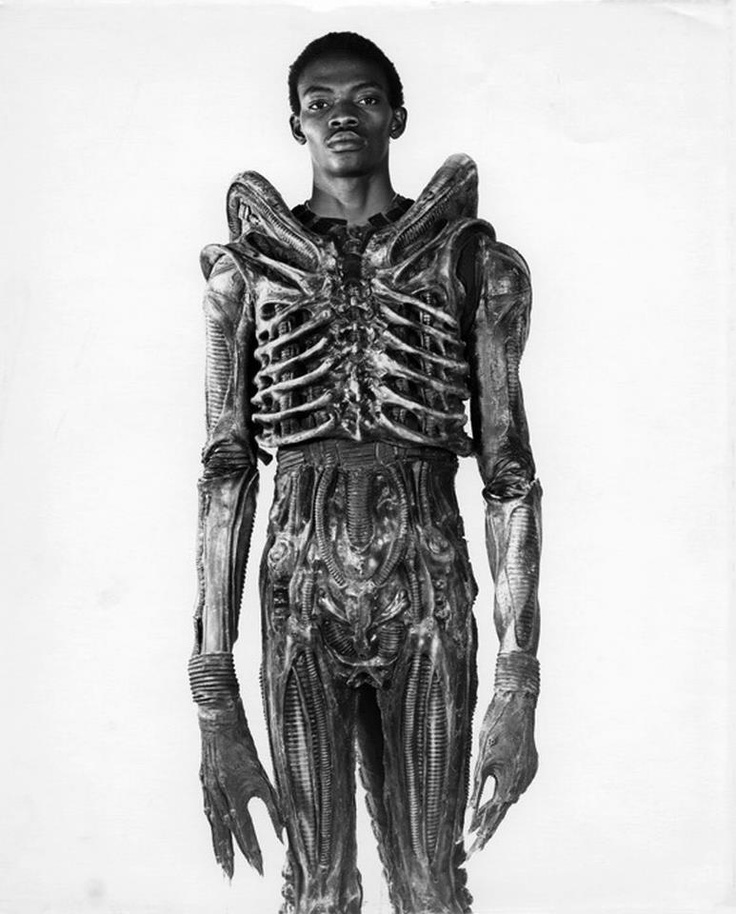 The first Alien    Why are Aliens soooo TALL?    Alien design by H.R. Giger    Alien suit performer bolaji badejo  http://alienanthology.wikia.com/wiki/Bolaji_Badejo    Photographer unknown