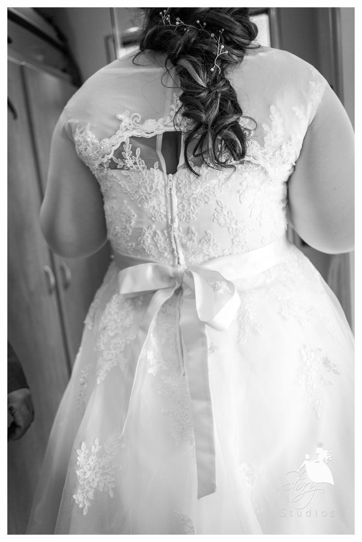 The back of the weddings dress with beautiful lace work and a lovely bow!