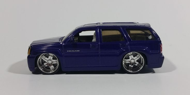 2004 Hot Wheels Dropstars Cadillac Escalade Purple Diecast Toy Car Vehicle 1:50 Scale - H2280 https://treasurevalleyantiques.com/products/2004-hot-wheels-dropstars-cadillac-escalade-purple-diecast-toy-car-vehicle-1-50-scale-h2280 #2000s #HotWheels #DropStars #Cadillac #Escalade #Purple #DieCast #Toys #Cars #Vehicles #Autos #Automobiles #Collectibles #VeryCool #MustHaves #BuyNow #SweetRides