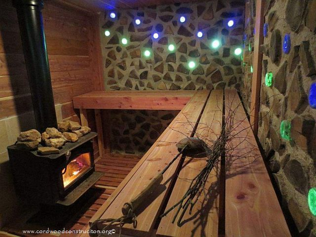 Cordwood glass bottle sauna interior sustainable - Construccion de saunas ...
