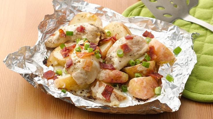 Chicken and potatoes sizzle inside a grilled foil packet with bacon and creamy ranch dressing.