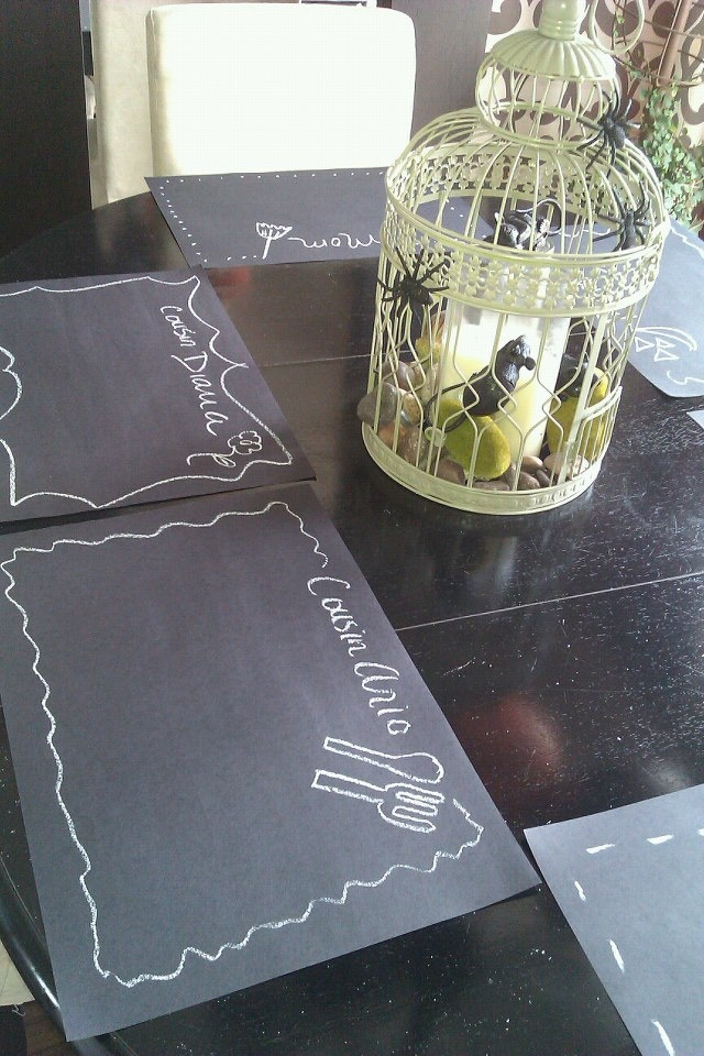 Use black construction paper and chalk to make unique and personal place mats :)