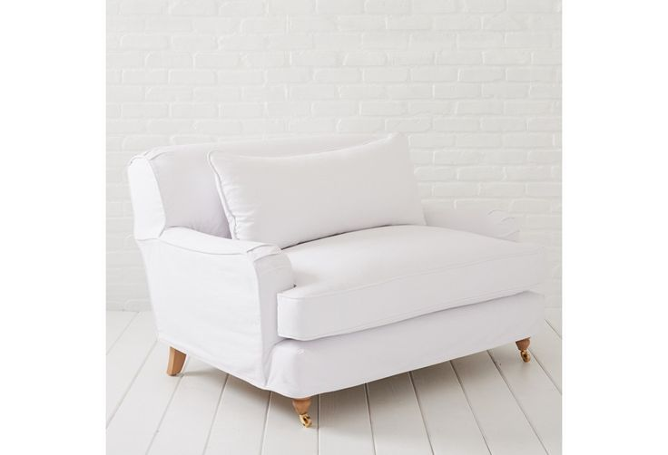 Portobello Chair and a 1/2 shown in a White Denim slipcover. Handmade in Los Angeles by quality craftsman using kiln dried hardwoods and eight-way hand tied construction. Easy slipcover design with down and feather or synthetic cushions. Slipcovers are machine washable. Other fabrics available through RASCC store locations and online at http://www.shabbychic.com #shabbychic #white #whitedenim #slipcover #washable #chair #madeinamerica