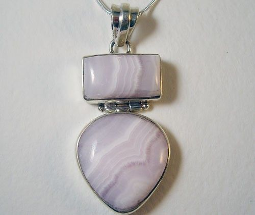 This beautiful pendant was handcrafted in 925 sterling silver and set with  a 55x123mm cabochon gem of light creamy-white banded  chalcedony (banded chalcedony is also known as agate).