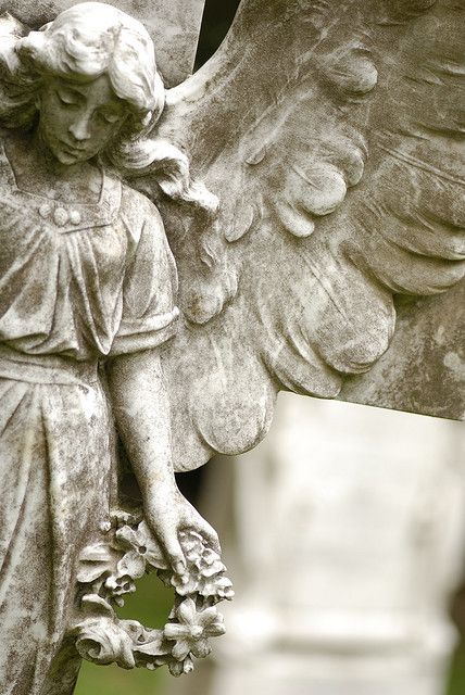 I love how the artist captures the angle of the angel and her wings - it gives it a feeling of movement