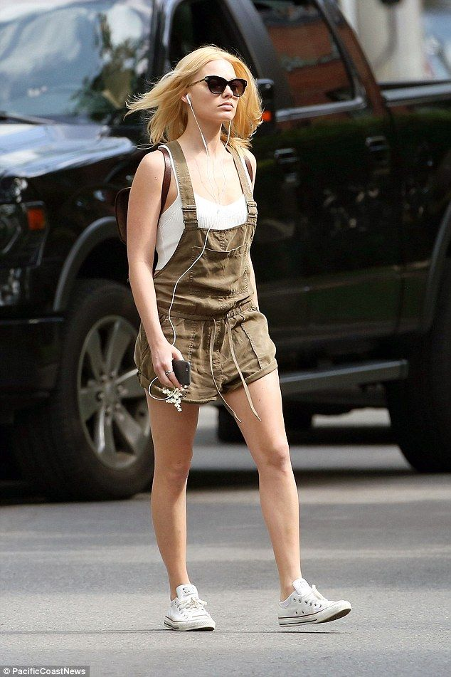 She's got some overall glam! The 24-year-old actress may have been a little miserable but ...