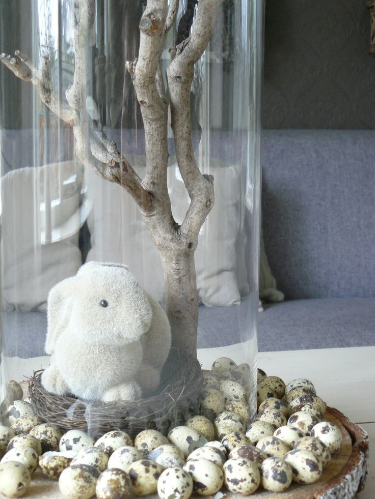 Spring or Easter centerpiece with bunny and branch covered cloche.