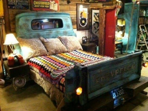 Repurposed truck parts make up the headboard and footboard for this unique bed — fully equipped with a lit license plate.