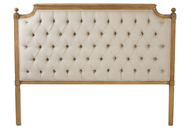 I love the tufted detail and natural wood frame. Gorgeous!