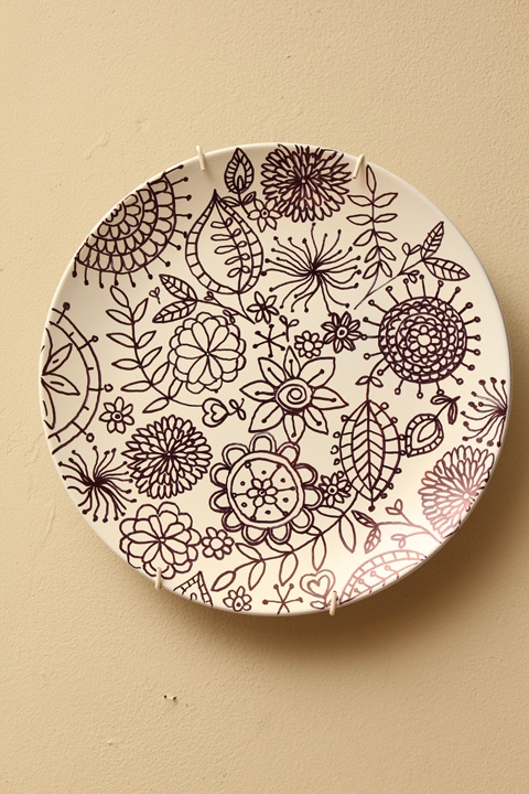 Plate spray painted white and decorated with a black sharpie - I think I could be creative with this!