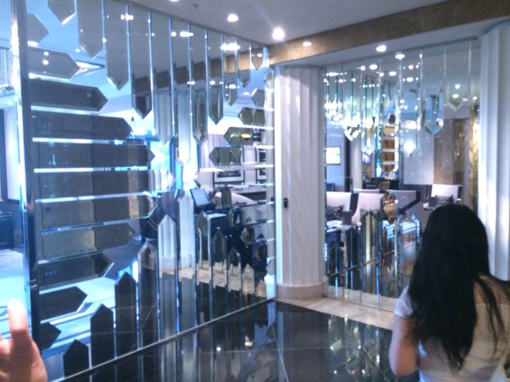 The entry wall to the crystal club in crown casino towers The mirror crystalline shards on this glazed wall creates a dazzling illusion of space behind reflected,cut up with the silvers of the space about to be entered.