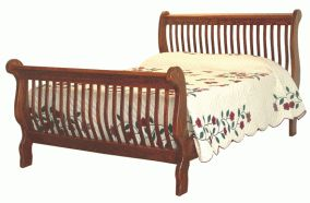Amish Craftsman sleigh bed hand crafted of solid hardwood, with foot and headboards made of slats. Available in various sizes and finishes.