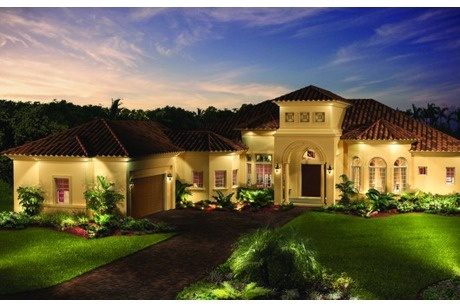 Twilight and extensive exterior lighting cast captivating shadows across this luxurious home. From London Bay Homes in Sarasota, FL.