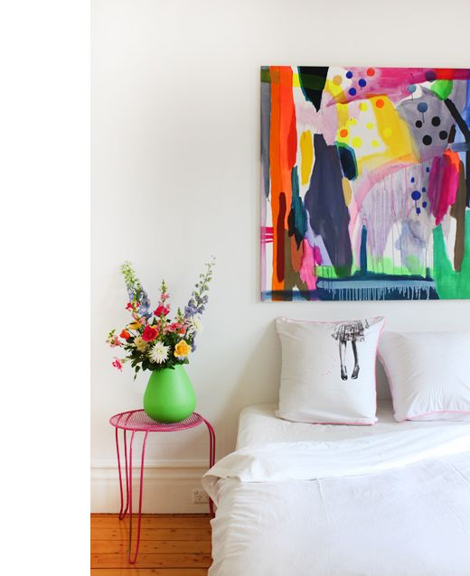 Love the artwork and use of colour in this vibrant bedroom. Heather Nette King via The Design Files.