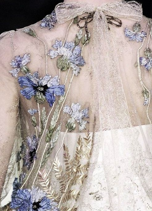 Christian Lacroix, flowers on her dress.