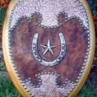 A VERY WESTERN COWHIDE & TOOLED LEATHER SEAT