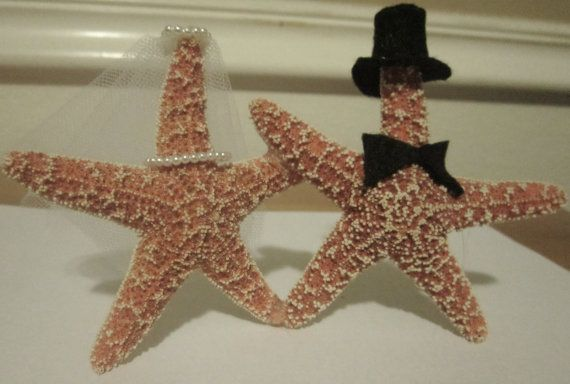 Beach wedding, baby. You can pick them up from   the source: http://www.etsy.com/listing/92012340/starfish-wedding-cake-topper