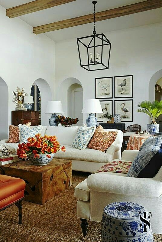 Summer thornton interiors white linen sofas wood beams and audubon prints are combined with blue and white chinese ginger jar lamps