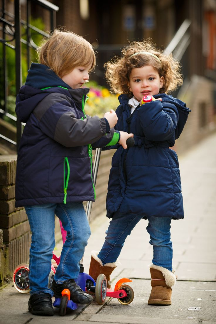 Boy And Girl Playing While Wearing The Hereo Gps Watch For