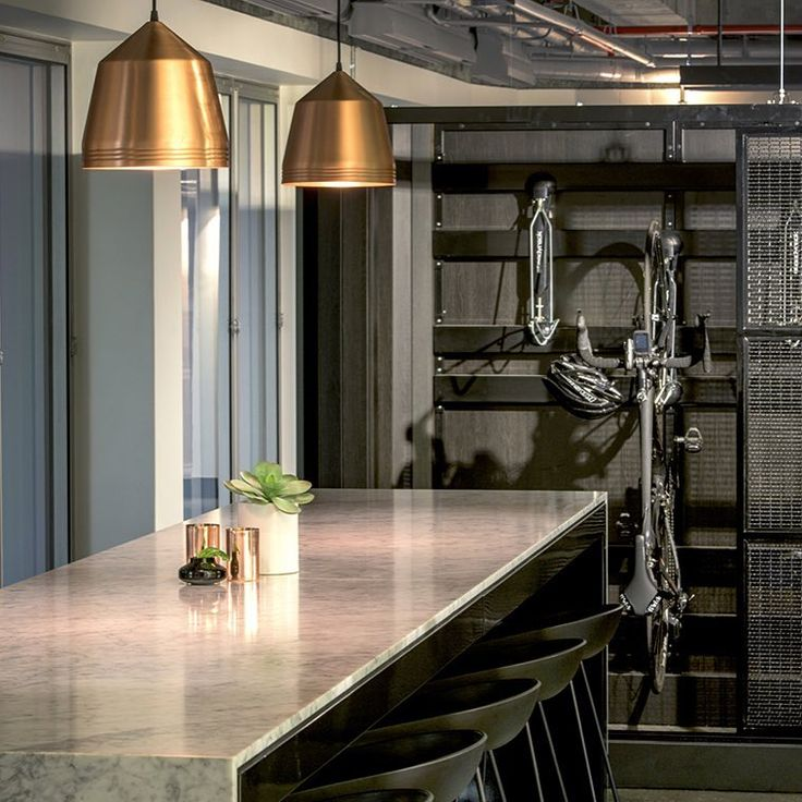 Brass Cooper pendants in the WA headquarters of Built, designed by Woods Bagot