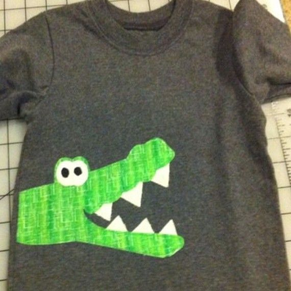 alligator on side of shirt