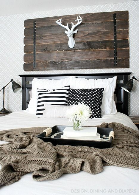 Rustic white bedroom inspiration with reclaimed wood wall decor, deer head, white bedding, and industrial black table lamps (scheduled via http://www.tailwindapp.com?utm_source=pinterest&utm_medium=twpin&utm_content=post87740785&utm_campaign=scheduler_attribution)