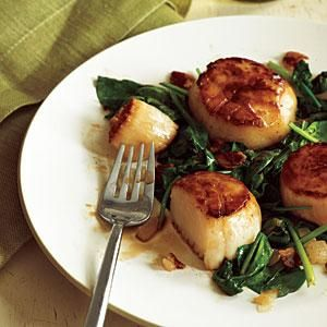 Scallops are simple to prepare, and with a screaming hot skillet, you get a gorgeous crust without having to bread the shellfish. Serve with a multigrain baguette and a glass of wine.